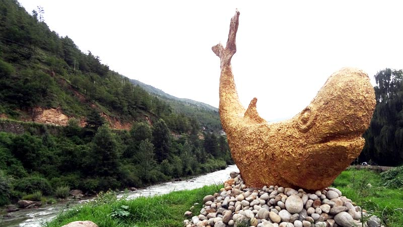 The Golden Fish is built from trash collected from the land reclamation along the Raidak River