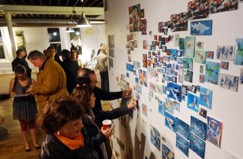 Give & Take - The Debris Project installation at PlatteForum invited participants to take a tile and contribute a new work to the installation