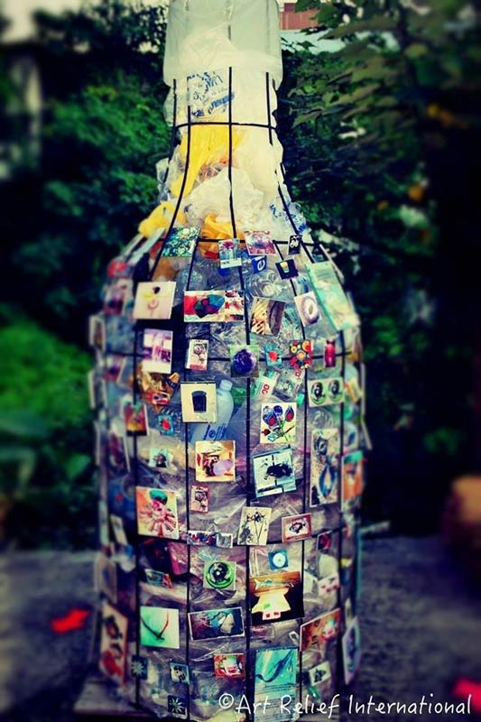 Bottle installation at Thapae East in Chiang Mai, Thailand. Photo by Patrick Reynolds for Art Relief International