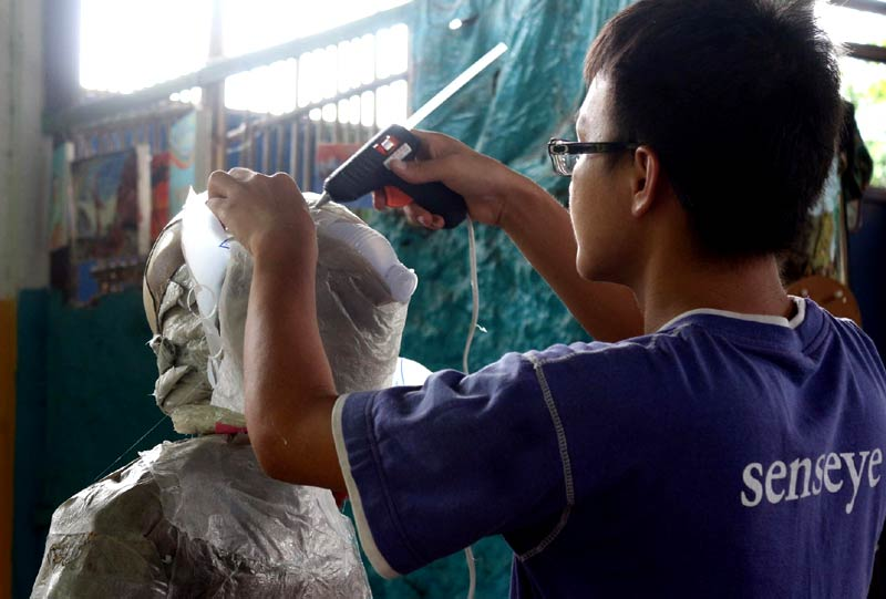 'Chevy' The Plastic Daemon was made at human scale to migrate around Northern Thailand to raise awareness of plastic pollution from the back of a motorbike