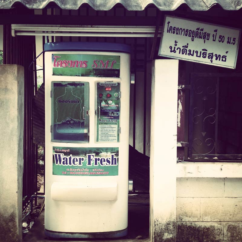 A filtered water re-fill station commonly found throughout Thailand offers inexpensive drinking water, which also cuts plastic bottle waste.