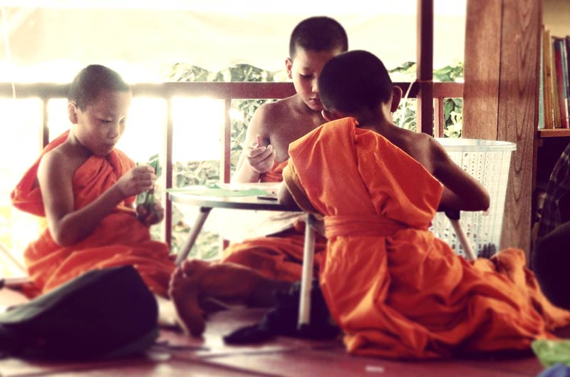 Students from the Schools of Hope work on Debris tiles during a workshop with the neighboring Wat in Northern Thailand